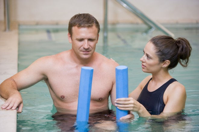 HydroKinetics - Instructor And Patient Undergoing Water Therapy